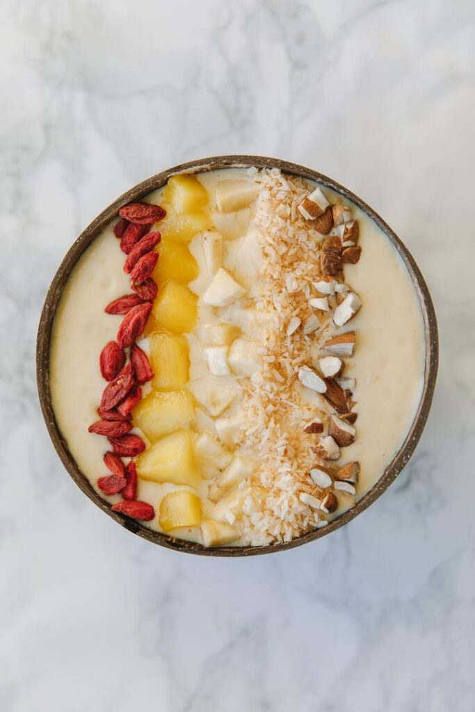 Yellow, orange and green smoothie bowl-spring edition