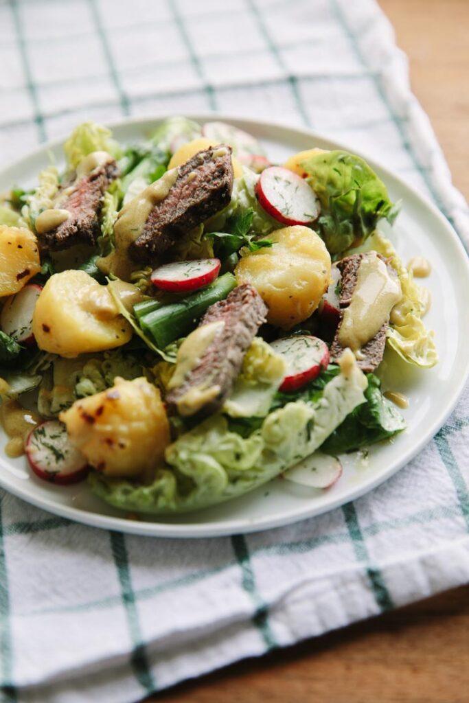 Sirloin, garlic potatoes and radish salad