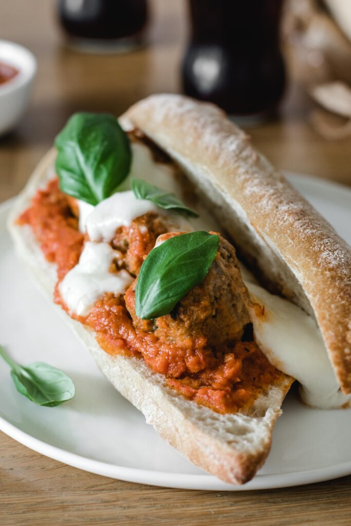 Meatball sandwich with mozzarella and basil