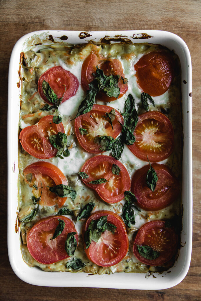 Vegeterian lasagna with tomatoes and mushrooms