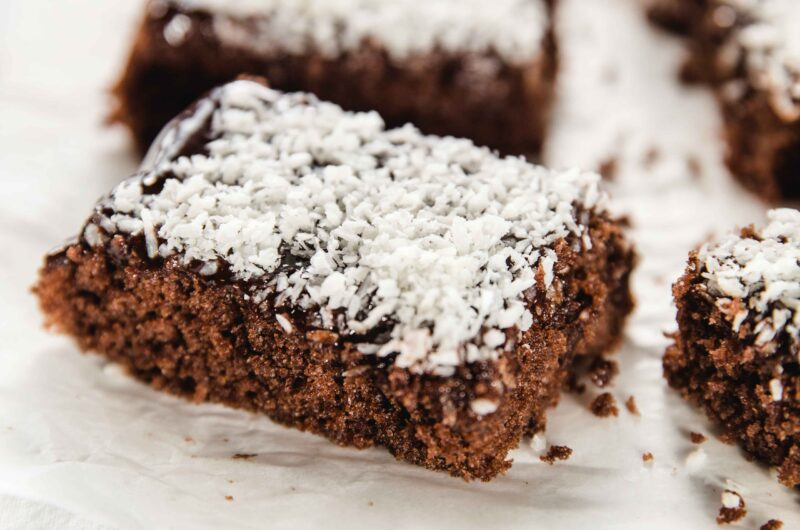 Easy chocolate sheet cake with ganache and coconut shavings