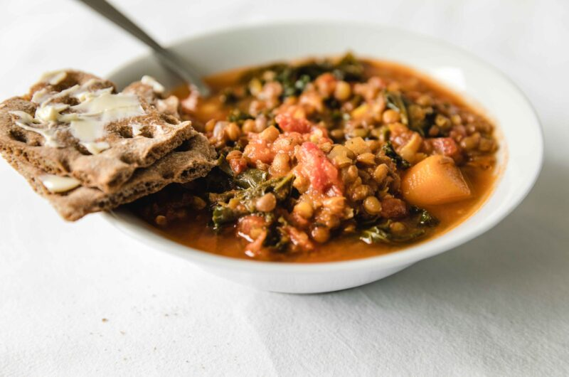 Lentil soup with curry and kale and lemon