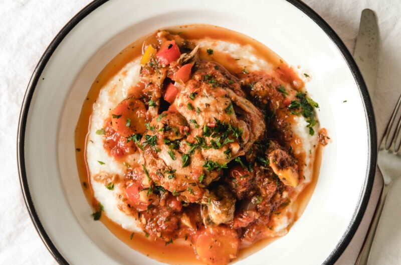 Chicken cacciatore with chicken thighs, vegetables and polenta
